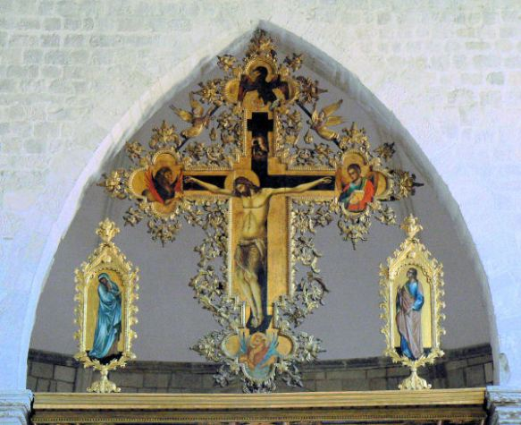 Golden cross above the altar